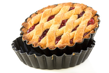 Cake with raspberry jam in the form of a non-stick coating.