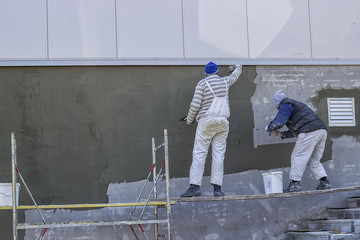 Workers plastering a outdoor wall 2