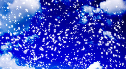 abstract snowflake star background against a blurry blue sky