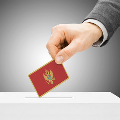 Voting concept - Male inserting flag into ballot box - Montenegr