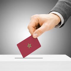Voting concept - Male inserting flag into ballot box - Morocco