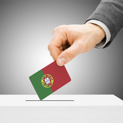 Voting concept - Male inserting flag into ballot box - Portugal