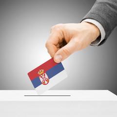 Voting concept - Male inserting flag into ballot box - Serbia