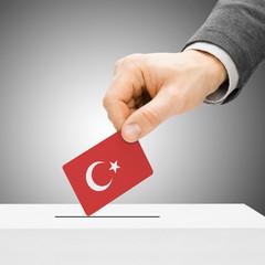 Voting concept - Male inserting flag into ballot box - Turkey