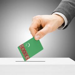 Voting concept - Male inserting flag into ballot box - Turkmenis