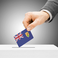Voting concept - Male inserting flag into ballot box - Turks and