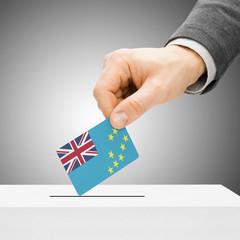Voting concept - Male inserting flag into ballot box - Tuvalu