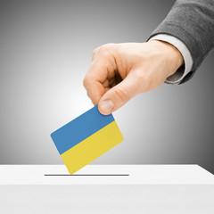 Voting concept - Male inserting flag into ballot box - Ukraine