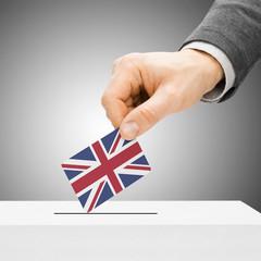 Voting concept - Male inserting flag into ballot box - United Ki