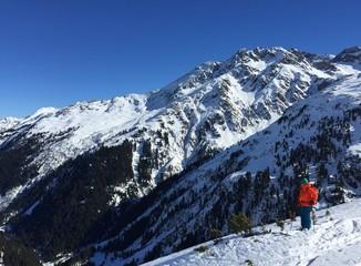 Female skier standing in winter mountain landscape in Austria