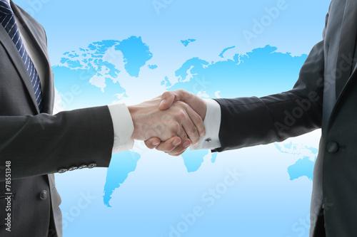 Leinwanddruck Bild Hand shake of businessman, globalization concept