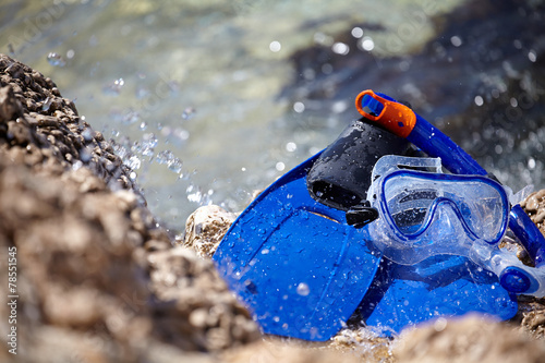 mask, snorkel and fins for snorkeling at the beach - 78551545