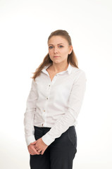 Young woman in a white shirt against white background