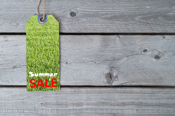 Summer sale concept with a sale tag on wooden table