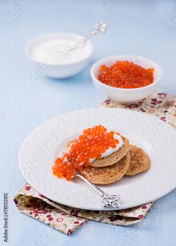 Buckwheat blini with red caviar and sour cream - 78552103