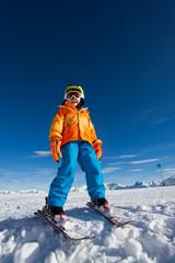 Smiling boy wearing ski mask and helmet in winter