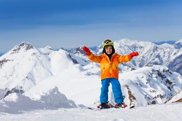 Happy boy skiing on Sochi ski resort, Russia