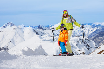 Mother with boy skiers in mountains