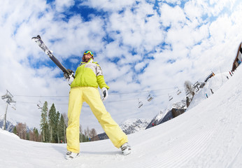 Cool girl in mask standing and holding ski