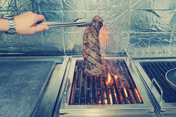 Meat on grill, toned image