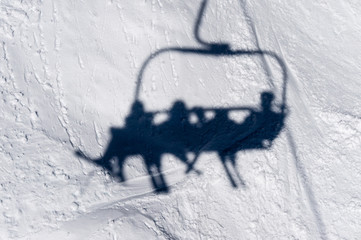 Shadow of Skiiers on Lift Chair