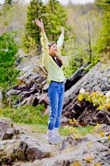 Girl raising hands in praise