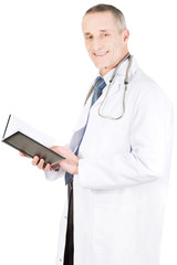 Mature male doctor holding notebook