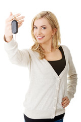 Happy woman holding a car key