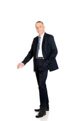 Full length businessman leaning on empty blank