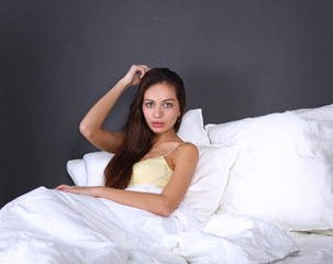 Pretty woman sitting in bed