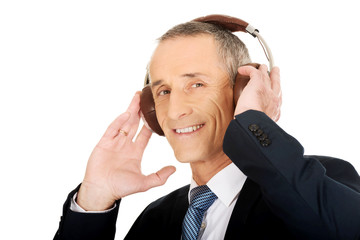 Portrait of businessman with big headphones