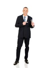 Full length businessman with light bulb