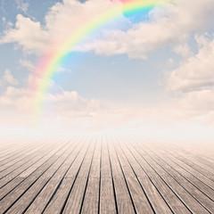 pier with rainbow on sunset