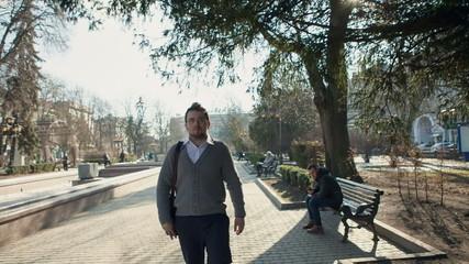 Businessman walking on a city street