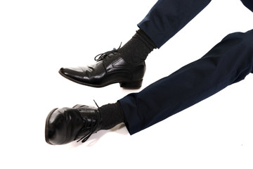 Close-up of businessman feet in black boots