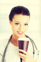 Woman doctor with a coffee.
