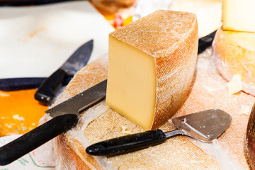 cheese on a wooden table with knife