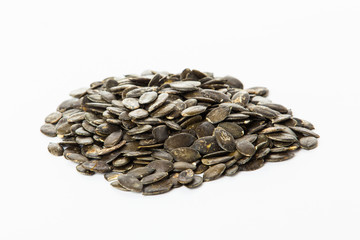 pumpkin seeds isolated on white background. Fresh roasted Pumpki