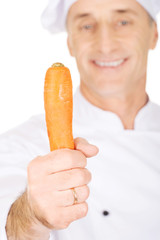 Male chef with a carrot