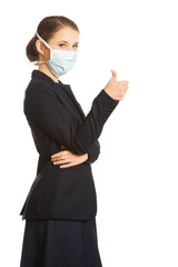 Businesswoman with protecting mask