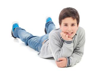 Smiling preteen boy lying on the floor