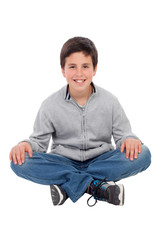 Smiling preteen boy sitting on the floor
