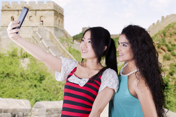 Casual women taking photos at Great Wall