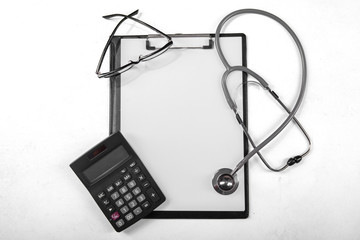 Clipboard with calculator and stethoscope