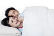 Couple having fun on bedroom