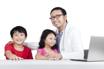 Friendly doctor with children 2