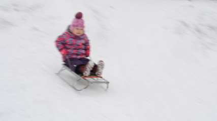 Child Sledding  on Hill, Kid Playing, Sledging in Park in Winter