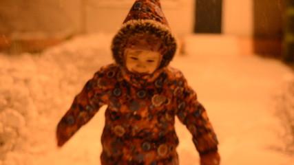 Little Girl Running on Snow Park, Night Light