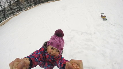 Happy Child  Rotates and Fall on the Snow, Slow Motion