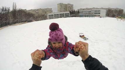 Happy Child Rotates in Winter Day, Slow Motion